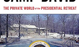 "Graphic cover of the book, ""Inside Camp David,"" by Rear Admiral Michael Giorg..."