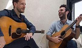 Promotional photo of Julian Lage and Chris Eldridge. By Devin Pedde. Courtesy...