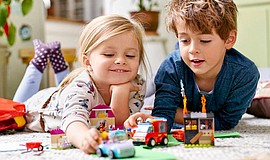 Promotional photo of children playing with Legos. Courtesy of LEGOS.