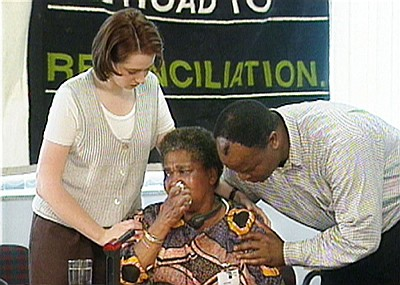 Eunice Miya (a Guguletu 7 mother) being comforted at the TRC hearings. Photo courtesy of IRIS FILMS