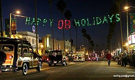 Promotional photo of previous Ocean Beach holiday parade. Courtesy of the Oce...