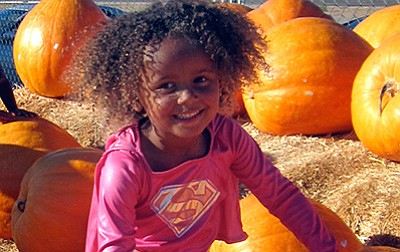 Promotional photo of young girl with pumpkins at Del Mar ...