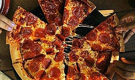 Promotional photo of pizza. Courtesy of Woodstock's Pizza Pacific Beach.