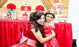 Promotional photo of princess Elena with a child. Courtesy of Mint Studio.