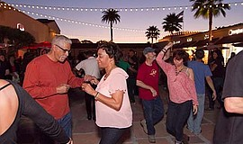 Promotional photo of previous salsa under the stars. Courtesy of The Headquar...