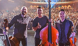Promotional photo of Simply Three picture at concert. Courtesy of Simply Three