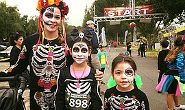 Promotional photo of family at previous Spooktacular Run-Walk. Courtesy of Sp...