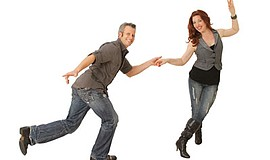 Promotional photo of Joel and Jackie Plys dancing