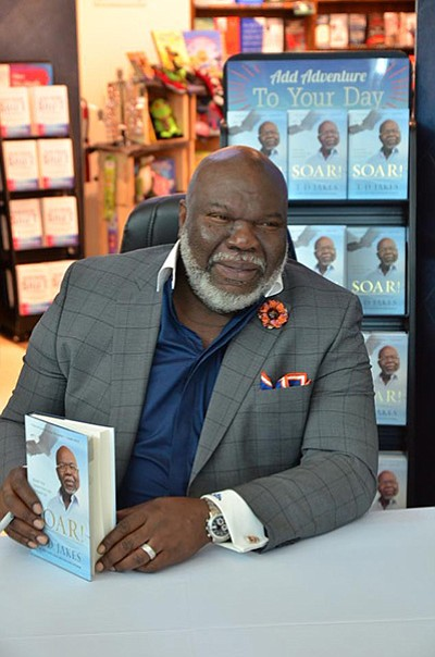 Promotional photo of T.D. Jakes at a book signing. Courte...