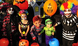 Promotional photo of kids enjoying Trick-or-Treat on India Street.