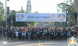 Promotional photo of participants in the Father Joe's Villages Thanksgiving D...