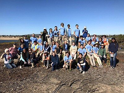 Promotional photo of volunteers that were helping to restore Nuttall's lotus in Mission Bay. Courtesy of San Diego Audubon Society.