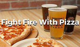 "Promotional graphic that reads ""Fight Fire with Pizza,"" for Woodstock's fundr..."