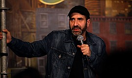 A promotional photo of comedian Dave Attell.