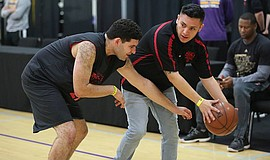 Participants play in a Special Olympics basketball game.