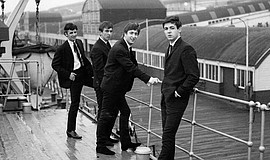 Promotional photo of The Beatles.