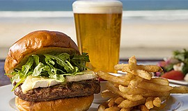 Promotional photo of beer and burger. Courtesy of The Shores restaurant.
