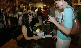 Photo of the Rother during a book signing. Courtesy of Caitlin Rother.