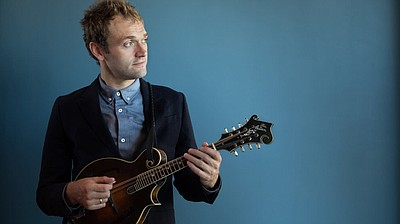 Promotional photo of Chris Thile. Photo by Devin Pedde