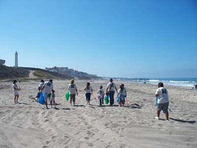Photo of a previous beach clean up. Courtesy of California Coastal Cleanup Day San Diego County.