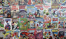 A photo of an arrangement of comic books.