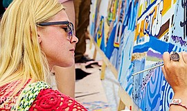 A participants contributes to the annual Community Mural at the Ocean Beach S...