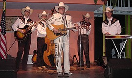 Photo of Cowboy Jack and his band performing live.