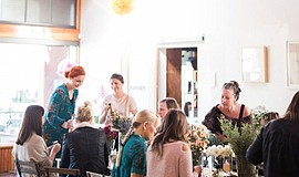 Promotional photo of the flower crown workshop. Courtesy of Native Poppy.