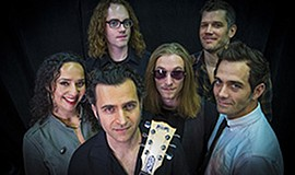 A photo of Dweezil Zappa and his band.