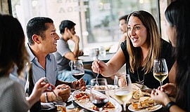 Promotional photo of people dining at Farmer's Bottega. Courtesy of Farmer's ...