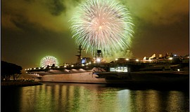 Promotional photo of fireworks aboard the USS Midway.