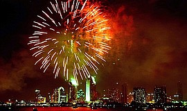 A photo of fireworks over San Diego bay.