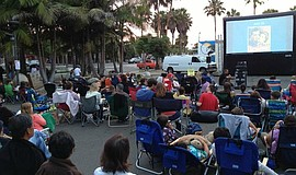 Families watch a movie at the Flicks at the Fountain series.