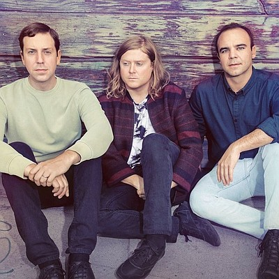 Promotional photo of Future Islands.