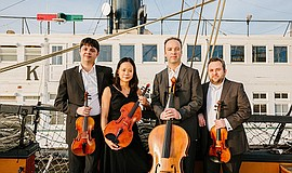 A photo of the Hausmann Quartet.