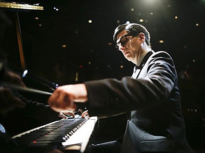 A photo of Hershey Felder as Irving Berlin.