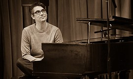A promotional photo of pianist Josh Nelson.
