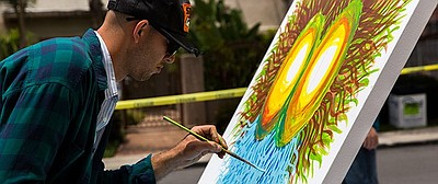 Promotional photo of an artist during the live urban art exhibition at the SDCCU Festival of Arts in North Park.