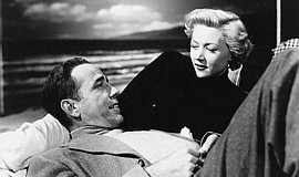 "Humphrey Bogart and Gloria Grahame in ""In a Lonely Place"" (1950)."