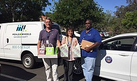 Photo of staff preparing to take meals to seniors in need. Courtesy of Meals ...