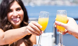 Photo of people toasting glasses of mimosas as part of Flagship's Mother's Da...