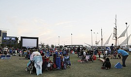 Community members at a Summer Movies in the Park.
