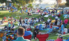 Families gather at Santee Lakes for the outdoor summer movie series.