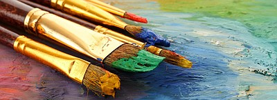 Promotional photo of paint brushes for OMA's Artist Allia...