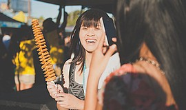 A photo of a guest at a previous San Diego Night Market.