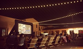An outdoor film screening at Headquarters' Courtyard.
