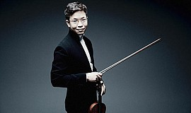 A promotional photo of violinist Paul Huang, by Marco Bor...