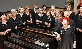 Photo of the members of the chorus. Courtesy of Pacific Women's Chorus.