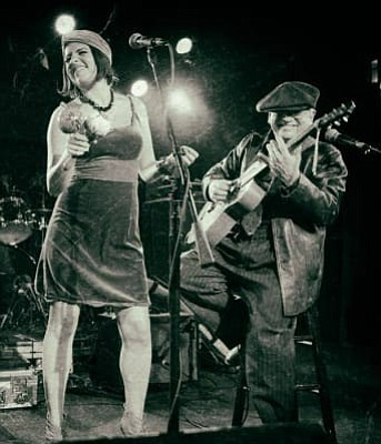 Robin Henkel performing with Whitney Shay.