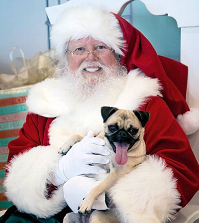 Photo from a previous Santa Paws event. Courtesy of Shawn...